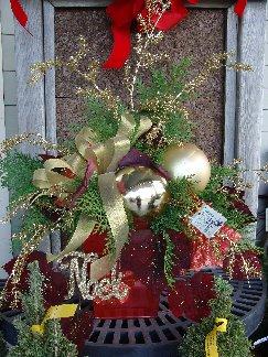 A pretty Holiday Porch Pot by Hillermann Nursery & Florist