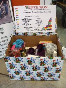 Decorated Holiday donation bin at Hillermann Nursery & Florist